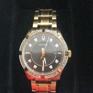 Bulova gold watch with diamonds